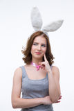 Happy thoughtful woman in rabbit ears Stock Photos