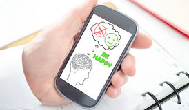 Happy thoughts concept on a smartphone Royalty Free Stock Photo