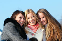 Happy three beautiful young women Stock Image