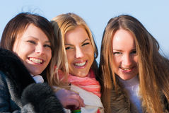 Happy three beautiful young women Stock Images