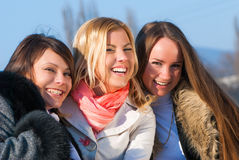 Happy three beautiful young women Royalty Free Stock Image
