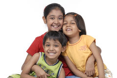 Happy three children. Portrait of two sisters and one brother Royalty Free Stock Photo