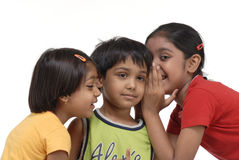 Happy three children. Two sisters and one brother Royalty Free Stock Photography