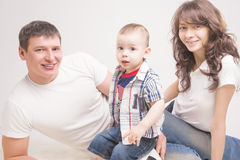 Happy three family members together Stock Images