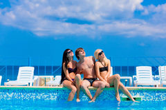 Happy three friends  by the pool Stock Photography