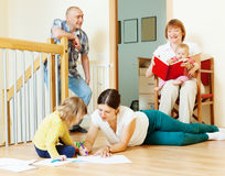 Happy three generations family  enjoying at home t Stock Photo