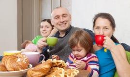 Happy three generations family having tea Royalty Free Stock Photography