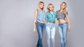 Happy three girls posing. Royalty Free Stock Photos