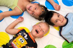 Happy three kids playing together Stock Photography