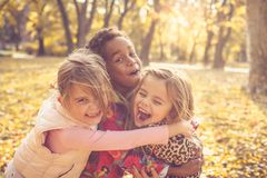 Three little girls in park. stock photo