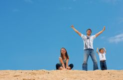 Happy three on sand dune top Royalty Free Stock Images