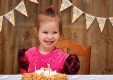 Happy three year old girl birthday. Happy three year old girl and her birthday cake with candles royalty free stock images