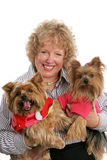 Happy Threesome. A happy pet owner holding her two adorable yorkie dogs Stock Photo