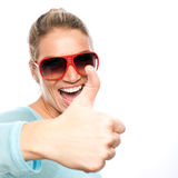 Happy thumbs up woman. Happy excited woman showing her thumbs up in a close up portrait Royalty Free Stock Photography