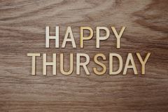 Happy Thursday text message on wooden background. Top view of Happy Thursday text message on wooden background royalty free stock photos