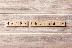 Happy thursday word written on wood block. Happy thursday text on table, concept.  stock photography
