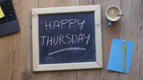 Happy thursday. Written on a chalkboard at the office royalty free stock photo