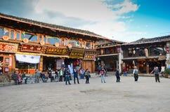 Happy Tibetan dancing in Shangri-La square Royalty Free Stock Photos
