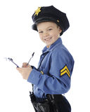 Happy Ticket Writer. An adorable elementary cop happily writing a ticket.  On a white background Stock Photo