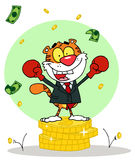 Happy tiger alated with victory,background. Successful tiger wearing boxing gloves and standing on a stack of coins Stock Image