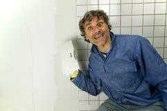 Happy tiler Stock Image