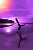 Happy times are here again. A happy young woman celebrating on an isolated irish beach in motion Stock Photo