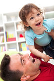 Happy times playing with dad Royalty Free Stock Photography