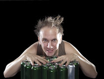 The happy tipsy man near empty beer jars Royalty Free Stock Images