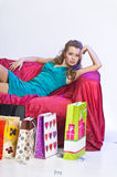 Happy and tired woman resting after shopping Stock Images