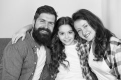 Happy to be a family. trust and relative bonds. bearded man and woman with child. happy family relax at home. family royalty free stock photos