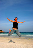 Happy to be on holiday2. Woman having fun on the beach royalty free stock images