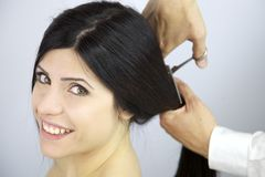 Happy to change hairstyle cutting my long hair Royalty Free Stock Photos