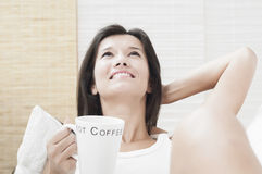 Happy to drink a cup of coffee Stock Images