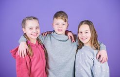 Happy to have such good friends. Teens friends. Girl and boy true friendship. Children smiling faces on violet. Background. Friends hug. Cheerful youth royalty free stock photography