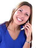 Happy To Hear It!. A smiling young woman in a blue top listens to her cell phone Stock Photo