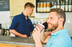 Happy to hear you. Man solving problems phone have coffee. Confident entrepreneur choose drink in paper cup to go while stock photography