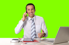 Happy 40 to 50 years old senior businessman working on computer isolated green chroma key Royalty Free Stock Photography