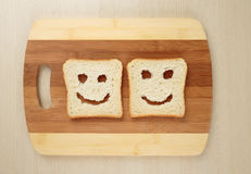 Happy toast. On a cutting board Stock Photography