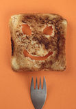 Happy toast and fork. On a  cutting board Stock Photos