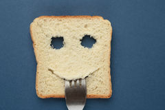 Happy toast with a fork in her mouth royalty free stock photo