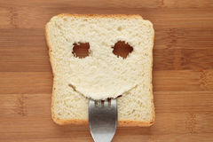 Happy toast with a fork in her mouth Royalty Free Stock Images