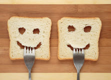 Happy toast with a fork in her mouth Stock Image