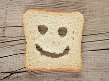 Happy toast on an old wooden Royalty Free Stock Photo