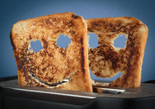 Happy toast in a toaster in the kitchen Royalty Free Stock Image