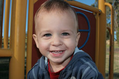 Happy Toddler. Playing in the playground stock photography