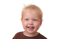Happy toddler. Portrit of a happy toddler on white background Royalty Free Stock Images