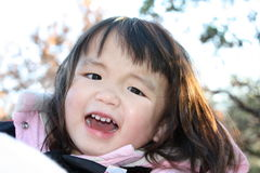 Happy Toddler. Female Asian toddler happy and content Stock Photo