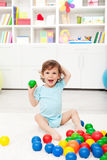 Happy toddler with balls Stock Images
