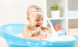 Happy toddler bathing in bathtub Royalty Free Stock Photography
