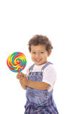 Happy toddler with big lollipop Royalty Free Stock Photo